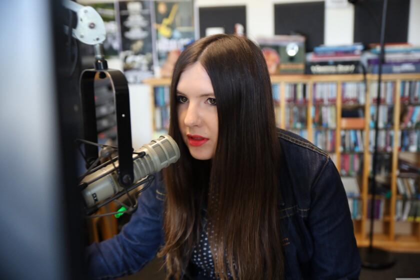 Kiana Lee broadcasting at the KPIG studio.
