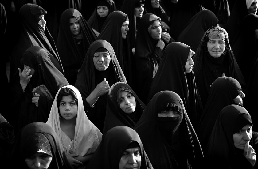 A group of women and girls in head coverings