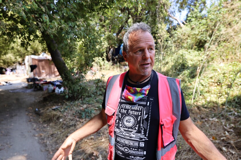 Brent Adams, of the Footbridge Services Center, talks about his program serving the homeless population at Camp Paradise.