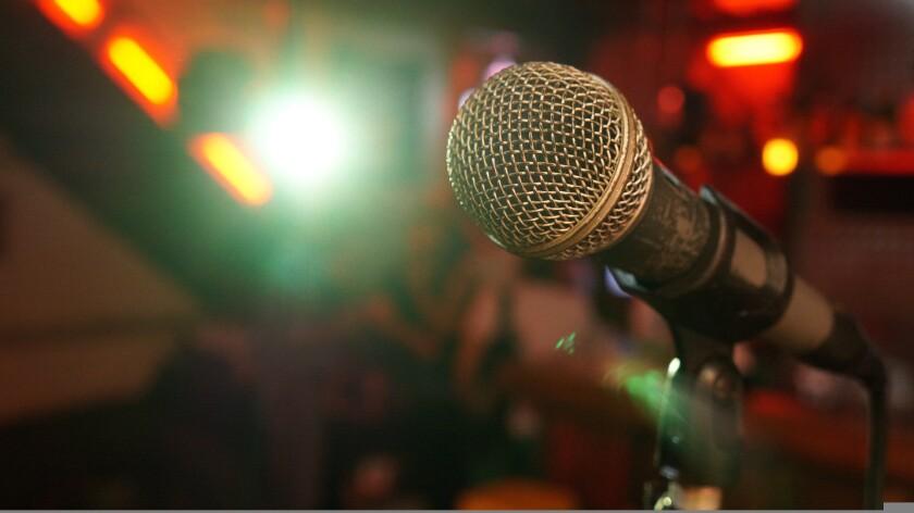 A microphone in a comedy club