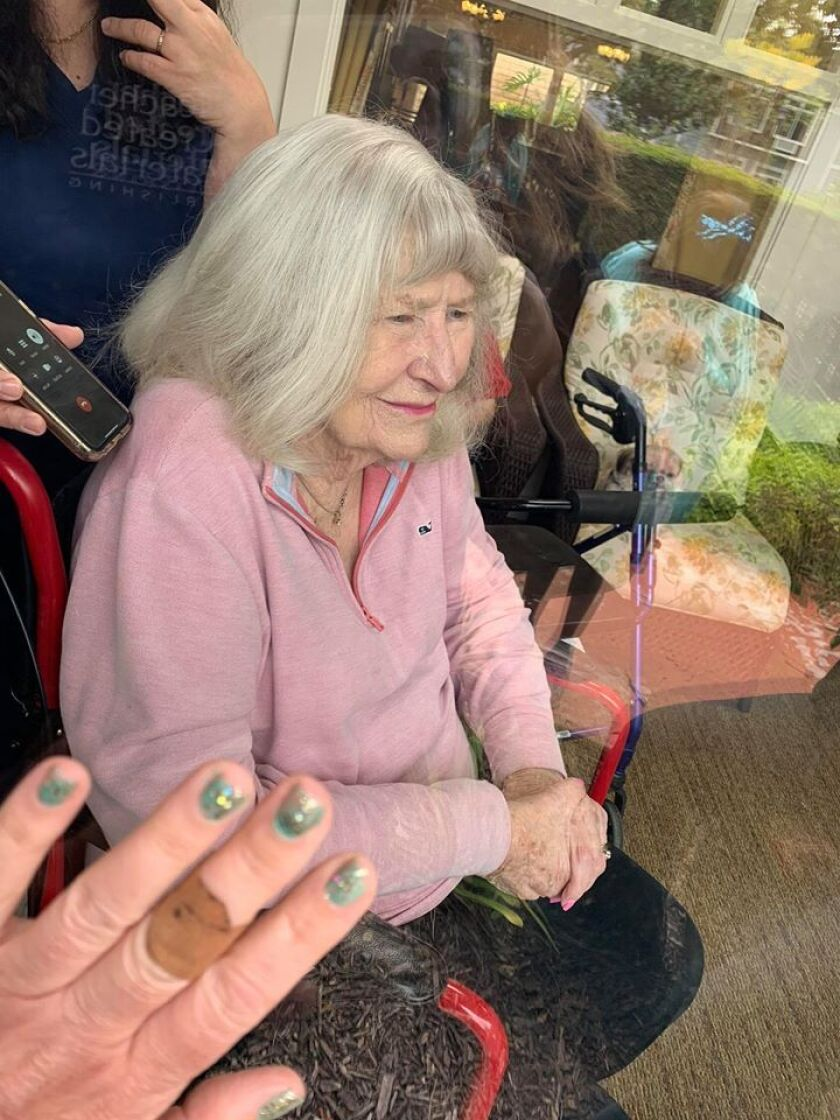 Dolores Cracchiolo's family often visited her through the window of her senior living facility during the pandemic.