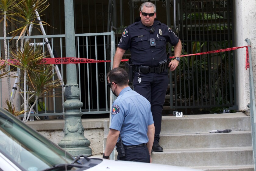 Police officers investigate a shooting in Orange, California