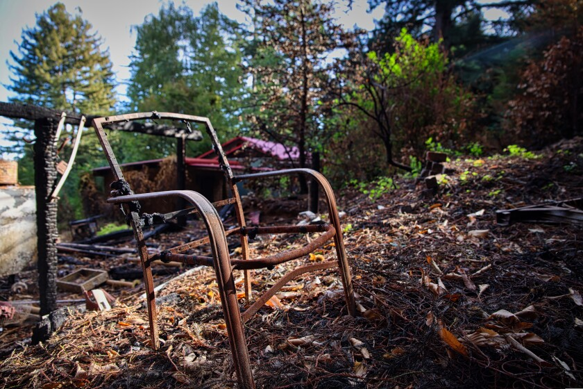 A burned chair frame is left after the CZU Lightning Complex fire crept on to Amber Turpin's Bon Lomond property.