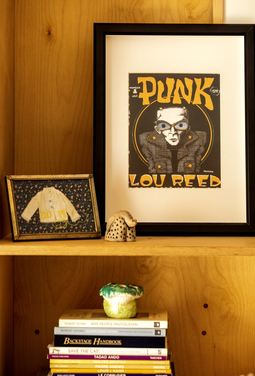 Books and decorative objects line the bookshelves.