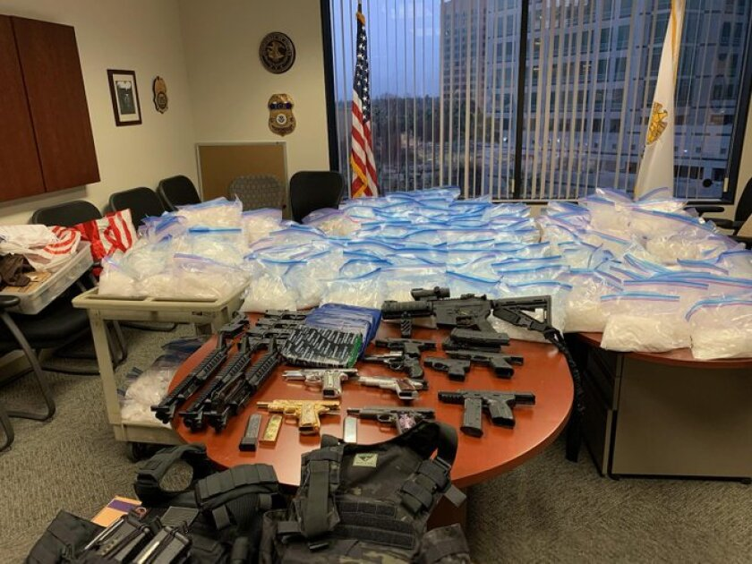 "Drugs and guns seized through ""Operation Burnt Orange."""