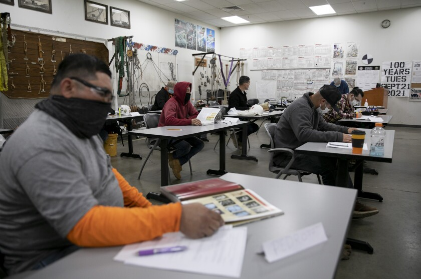 Seventh-and eighth-period apprentices, those who are nearly finished with the program, take a history class at the Ironworkers Local Union 377 training center in Benicia on June 10, 2021. Photo by Anne Wernikoff, CalMatters