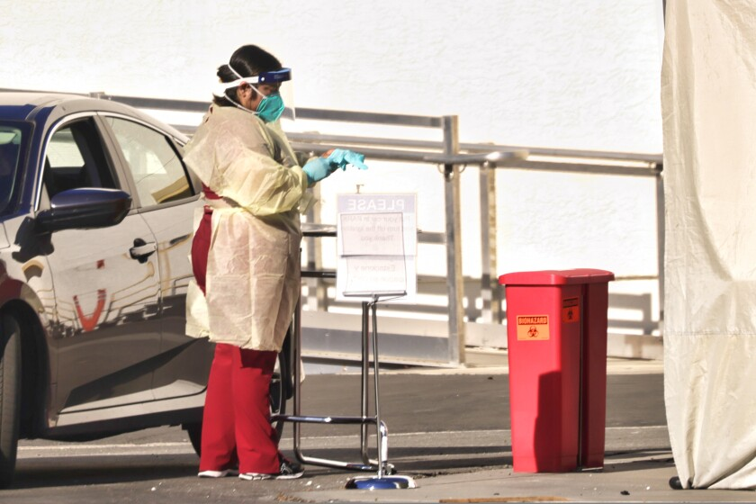 covid nurse at drive-thru testing site