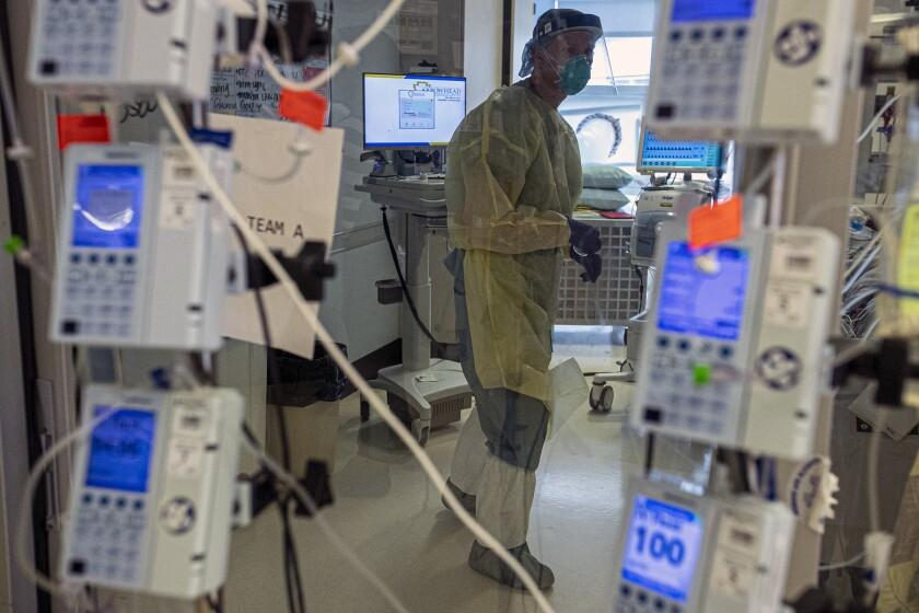 A nurse attends to a coronavirus patient