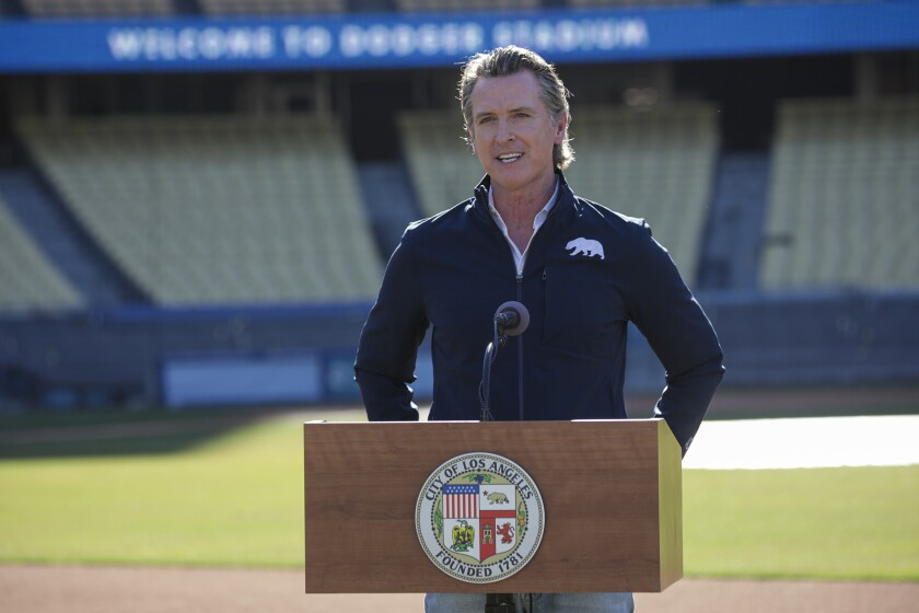 Los Angeles, CA - January 15: Governor Gavin Newsom addresses a press conference at Dodger Stadium