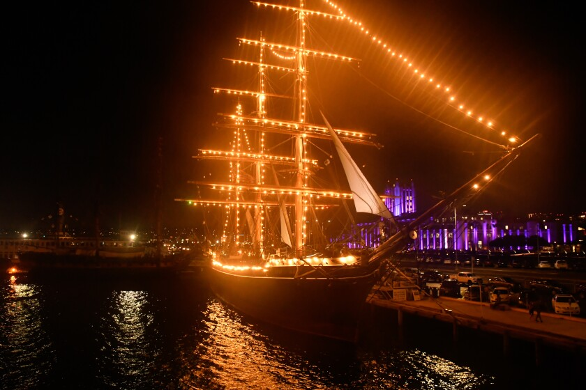 A ship is covered in lights in San Diego.