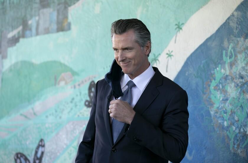 Gov. Gavin Newsom prepares to speak at a news conference