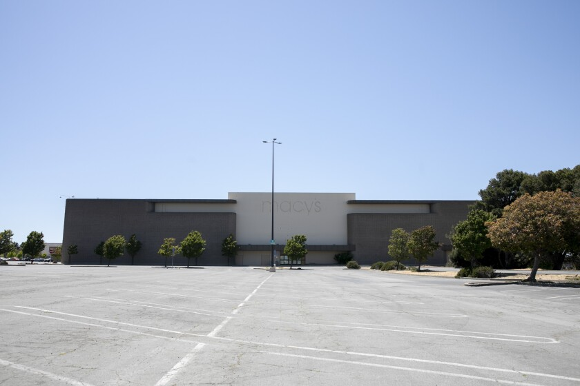 A shuttered Macy's store looms over an empty parking lot at Hilltop Mall in Richmond on June 10, 2021. The property was recently purchased by industrial property owners Prologis who, according to SFGate, intend to use the empty property for a mixed-use development including housing. Photo by Anne Wernikoff, CalMatters