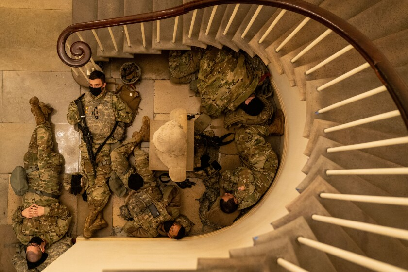 National Guard sleep in the halls of Capitol Hill as the House of Representatives convene to impeach President Donald Trump