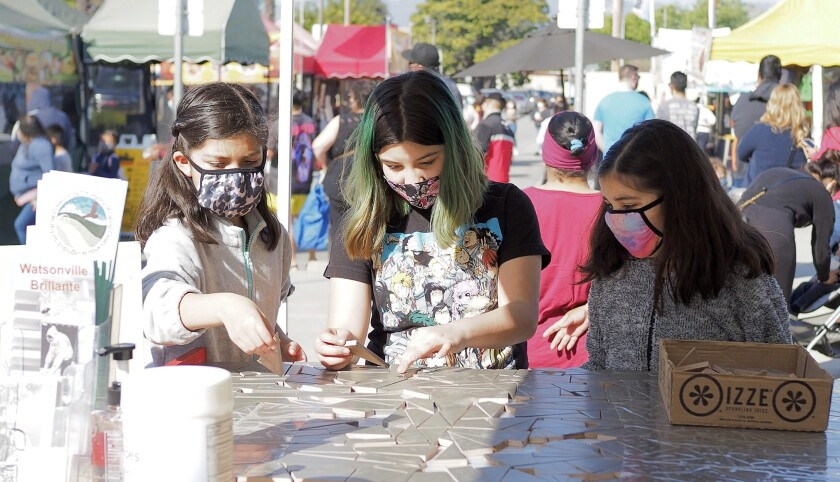 The Mobile Mosaic Unit attracts young artists at local farmers' markets.
