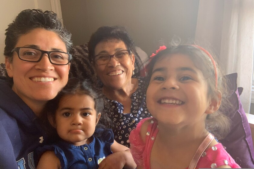 Esperanza Chavez (center) has diabetes but doesn't qualify for Medicare because of her immigration status.