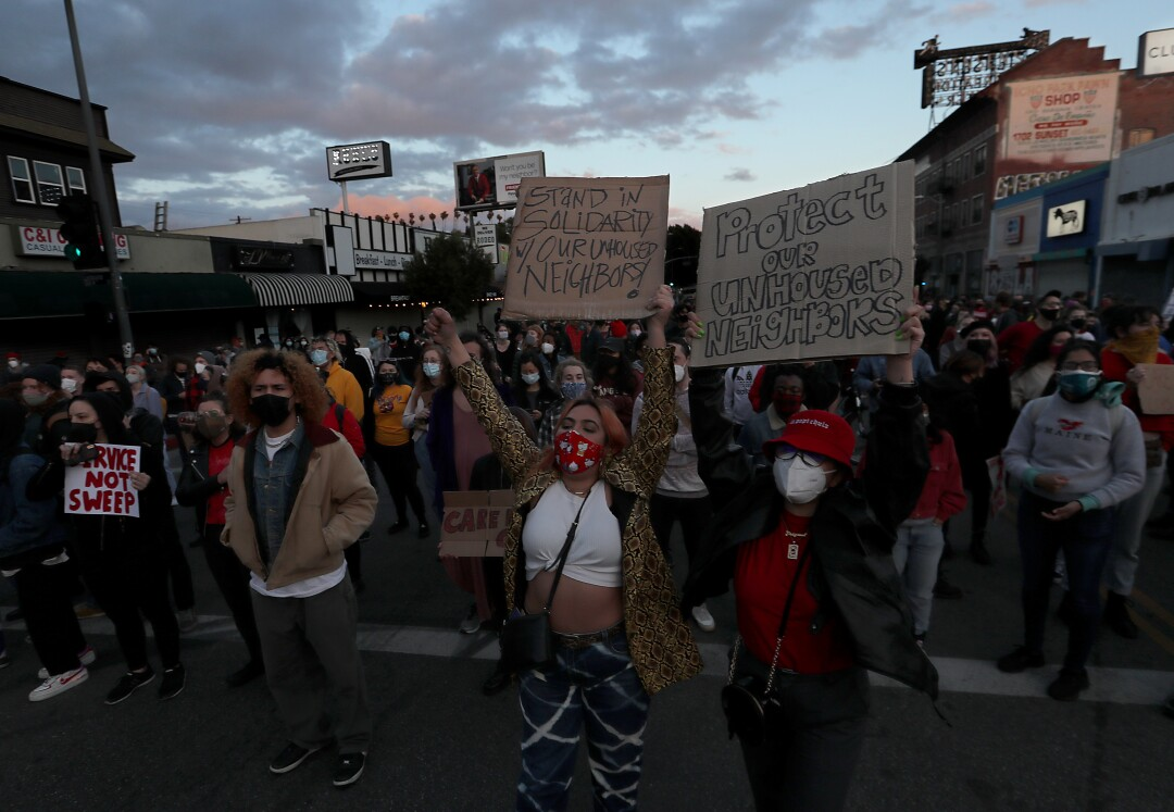 People march down Sunset Boulevard to protest the closure of a homeless camp in Echo Park.