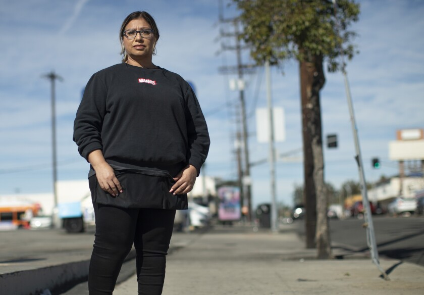 Susan Hernandez is a cashier at Food 4 Less in North Hollywood.