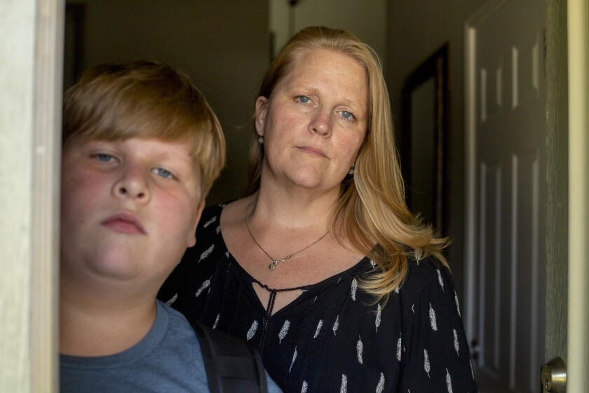 Kayden Christiansen and his mother, Heather Christiansen, at their home in Simi Valley