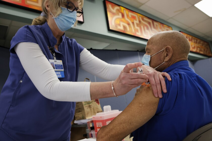 A man gets COVID-19 vaccine in Santa Cruz County on Jan. 12, 2021
