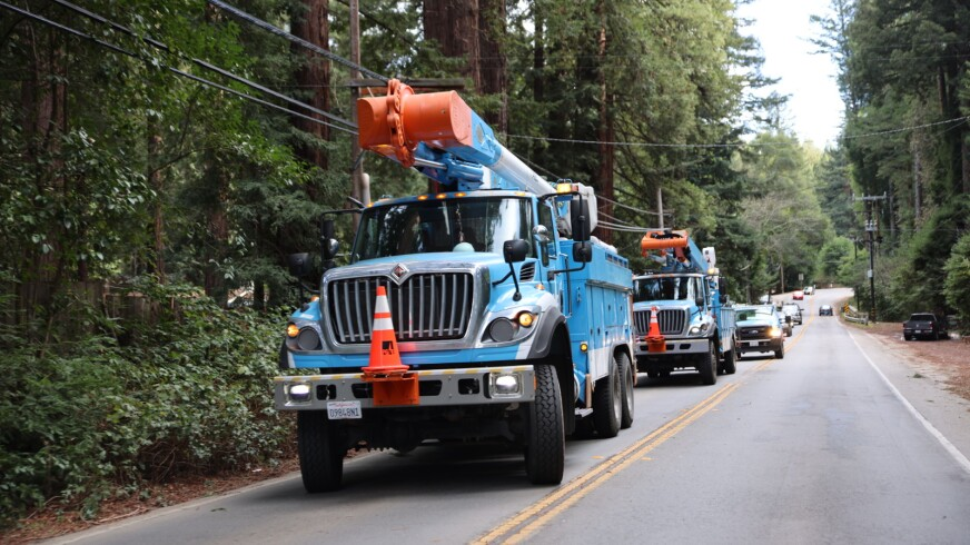 Utility trucks and cars in the Santa Cruz Mountains on Jan. 25, 2021.
