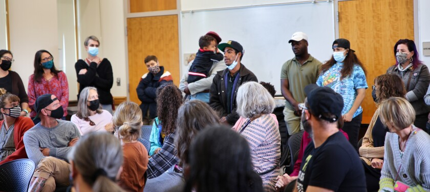 Local activist Thairie Ritchie speaks at Sunday's meeting.