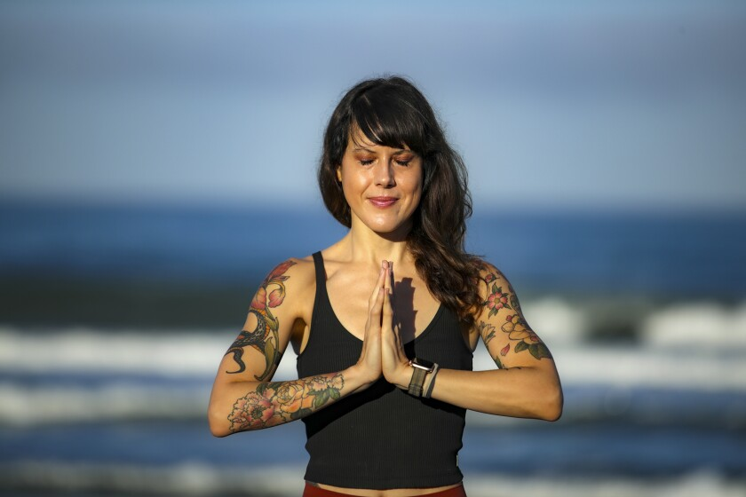 A yoga teacher Laura Schwartz in Carlsbad who closed her yoga studio after her business partner embraced conspiracy theories