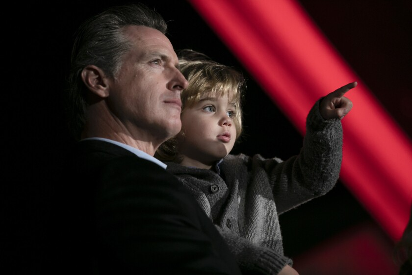 Gov. Gavin Newsom with his youngest son, Dutch, during the annual Christmas tree lighting at the Capitol on December 15, 2019