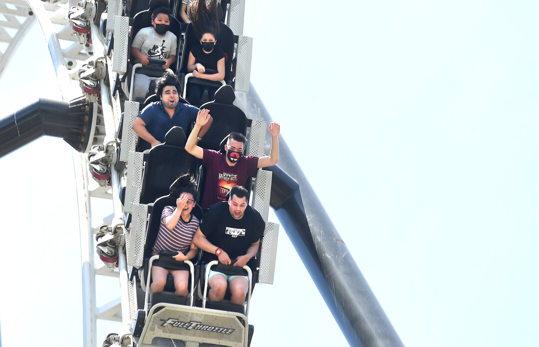 Riders on a roller coaster