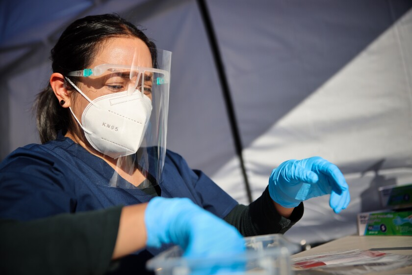A healthcare worker works at the Senneca Diagnostics COVID-19 testing facility in Twin Lakes