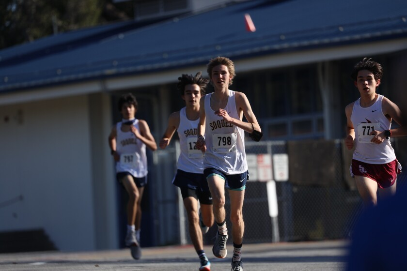 The Soquel and Santa Cruz boys do battle on the track at Soquel High.