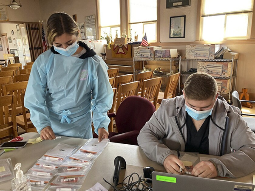 Health care employees work at the COVID-19 testing site at Veterans Hall in Fort Bragg on August 10, 2021.