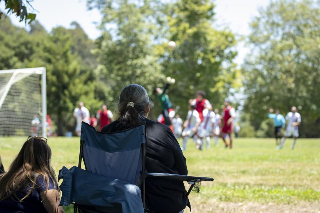 Teresa Jimenez watches her sons David and Issac play Sunday at Pinto Lake Park.