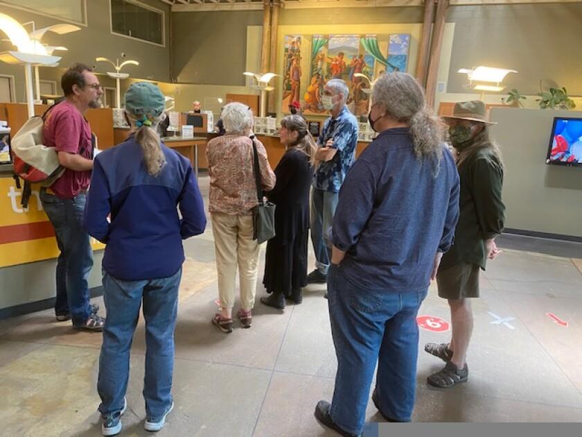 Micah Parsons (far left) inside Santa Cruz Community Credit Union.