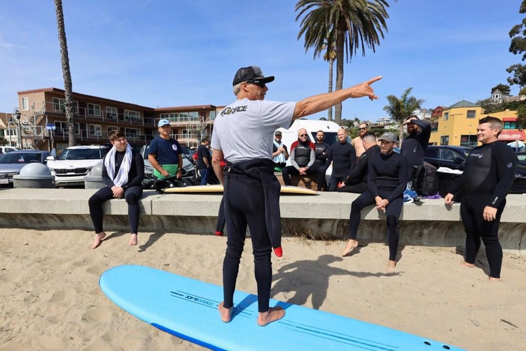 Richard Schmidt puts students through the pre-surf paces at Capitola.