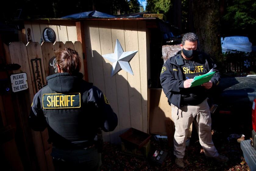 Santa Cruz County Sheriff's officers went door to door in threatened areas on Monday.