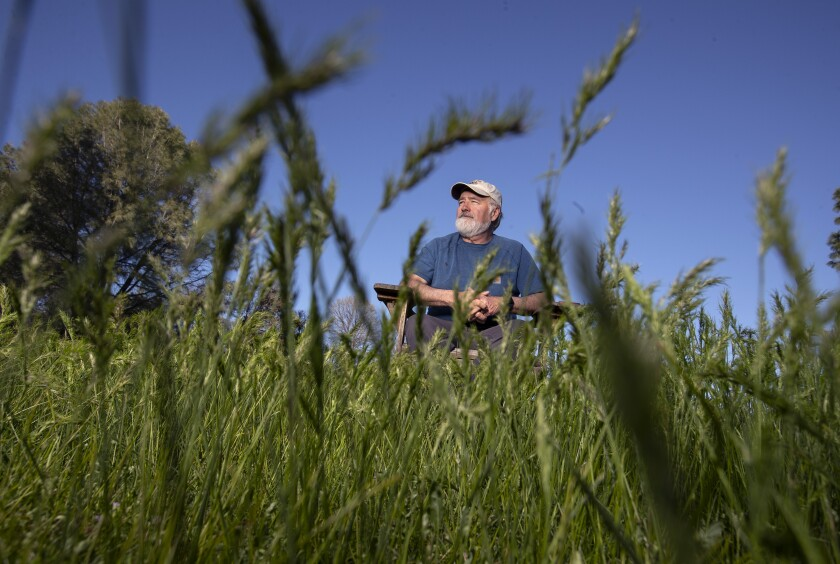 Steven Schwarzbach enjoys an afternoon in the yard of his home in Placerville.