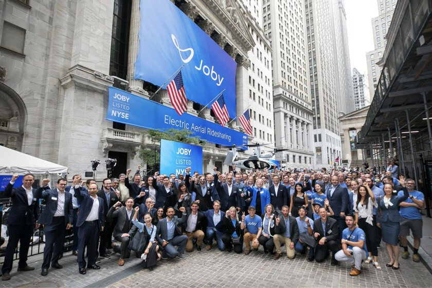 CEO JoeBen Bevirt, the Joby Aviation team and one of its electric aircraft celebrate outside the New York Stock Exchange