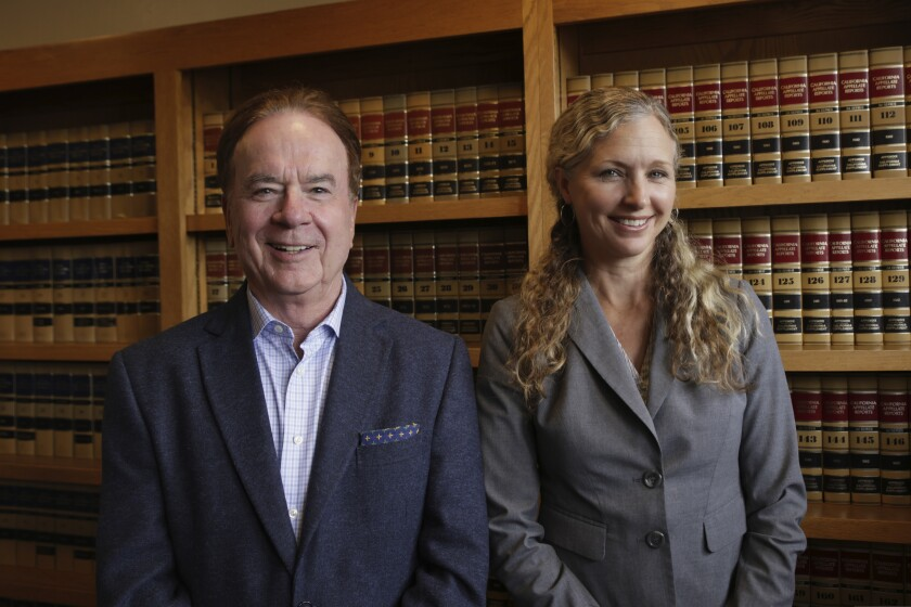 Larry Biggam, whose firm holds the main indigent defense contracts for Santa Cruz County, stands with Heather Rogers.