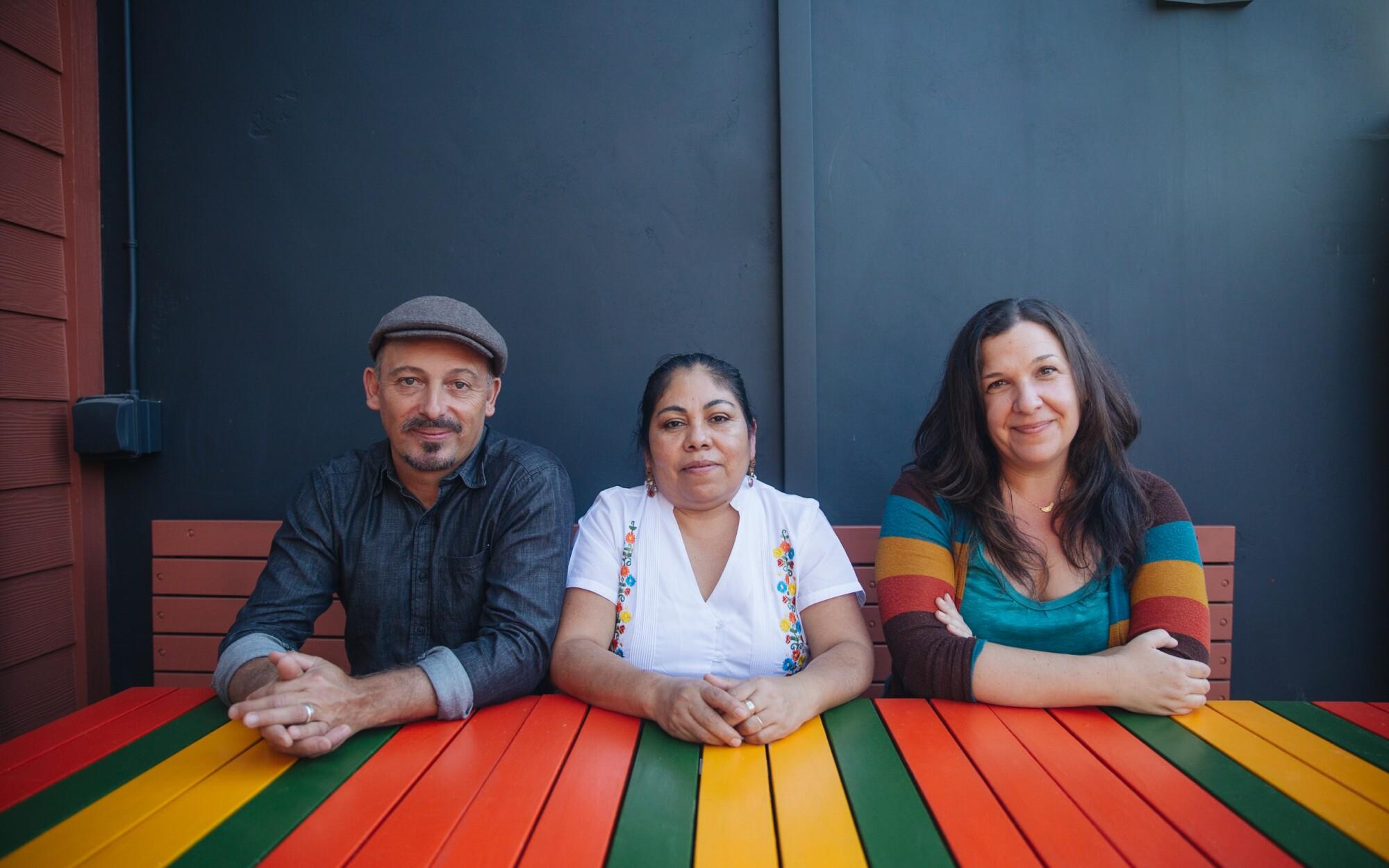 Copal owners Stuyvie Bearns Esteva and Noëlle Antolin flank Executive Chef Ana Fabian Mendoza.