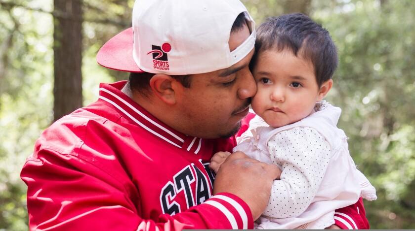 man holding child