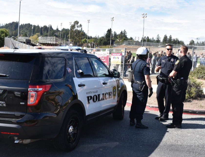 Scotts Valley police officers convene outside a school in 2019.