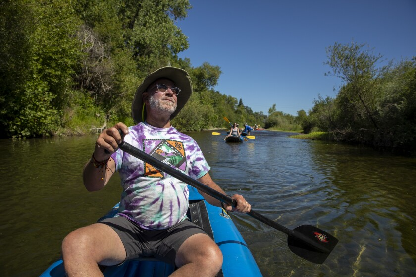 Larry Laba, owner of Russian River Adventures, paddles down the Russian River in Healdsburg, Calif.