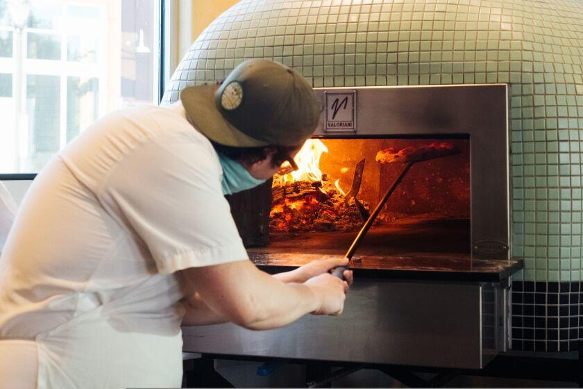 The Mugnaini pizza oven does the trick at Mentone.