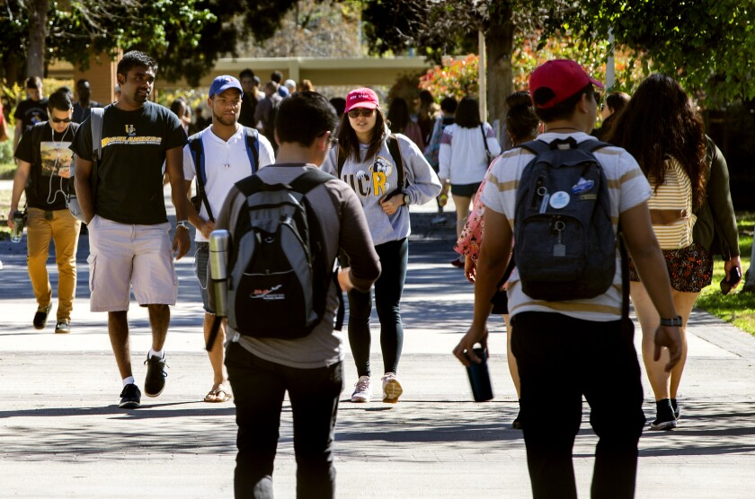 RIVERSIDE, CA - MARCH 9, 2017: The student body population at UC Riverside is very diverse, in fact, African American students thrive at UC Riverside, with some of the nation's highest graduation rates for their demographic on March 9, 2017 in Riverside, California. The Inland Empire campus has no racial disparity in graduation rates, a rare achievement. (Gina Ferazzi / Los Angeles Times)
