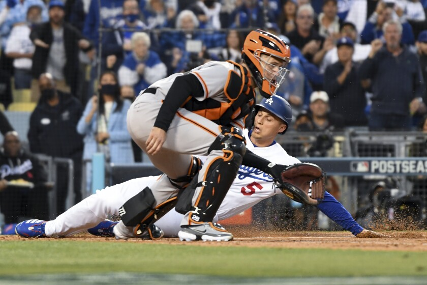 Dodgers' Corey Seager scores past San Francisco Giants catcher Buster Posey on an RBI double by Trea Turner.
