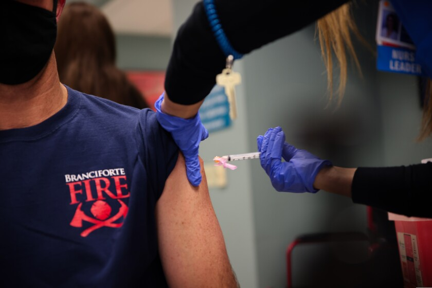 A firefighter from the Branciforte Fire Protection District in Santa Cruz gets vaccinated this year