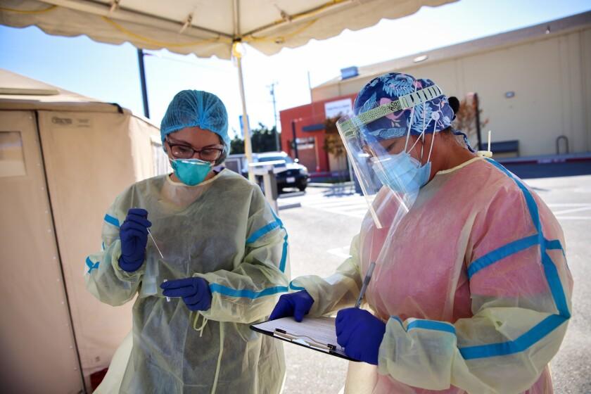 Two nurses at a COVID-19 testing facility in Santa Cruz County.