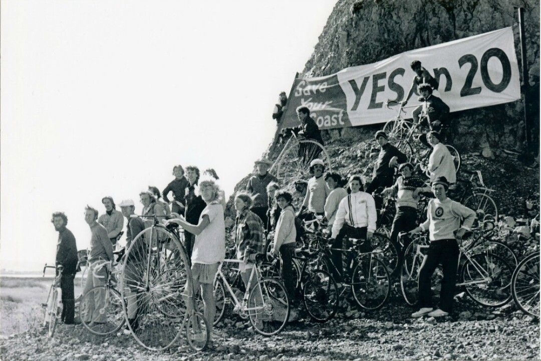 A group of bicyclists rally around a Yes on Prop 20 sign in 1972