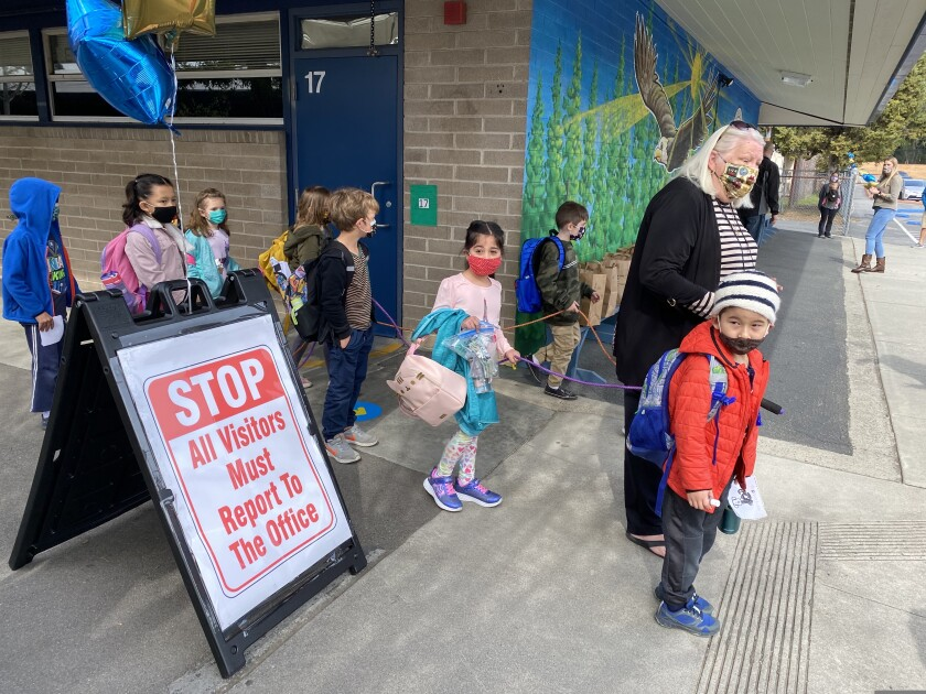 Brook Knoll kindergarten teacher Krista Patterson walks her students out of school.