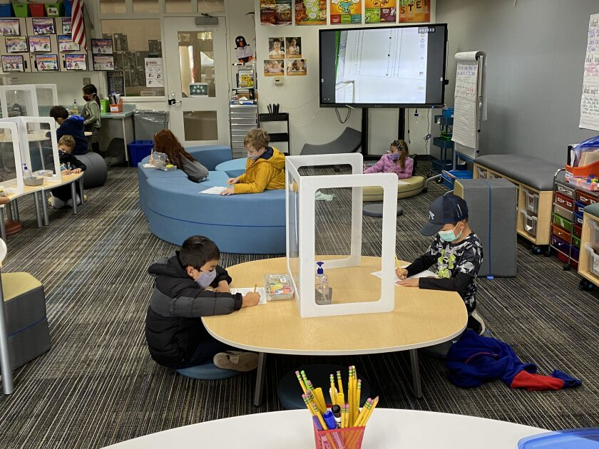 Students work independently in the new modern classroom.